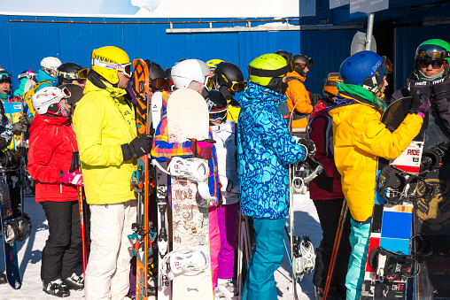 Skiers queue to the lift in ski resort, a lot of people.  North Russia,   Khibiny Mountains/