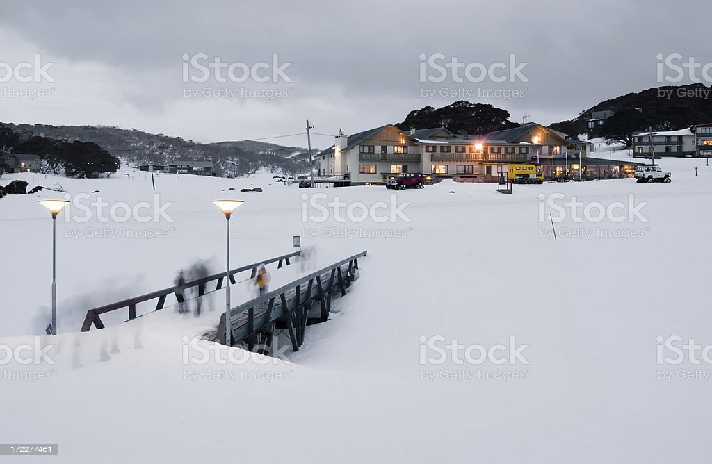 Skiers return to lodge royalty-free stock photo