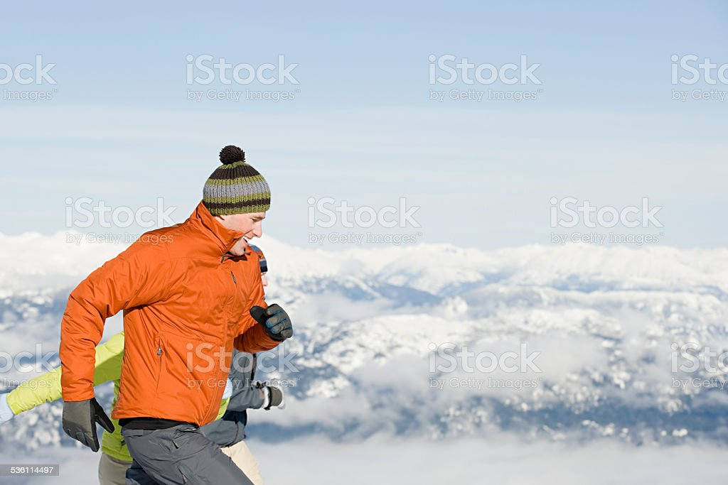 Skiers running stock photo