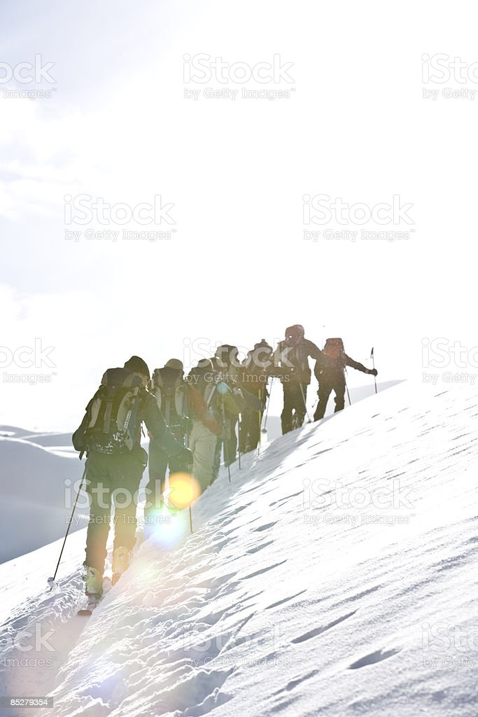 Skiers skin up a mountain. royalty-free stock photo