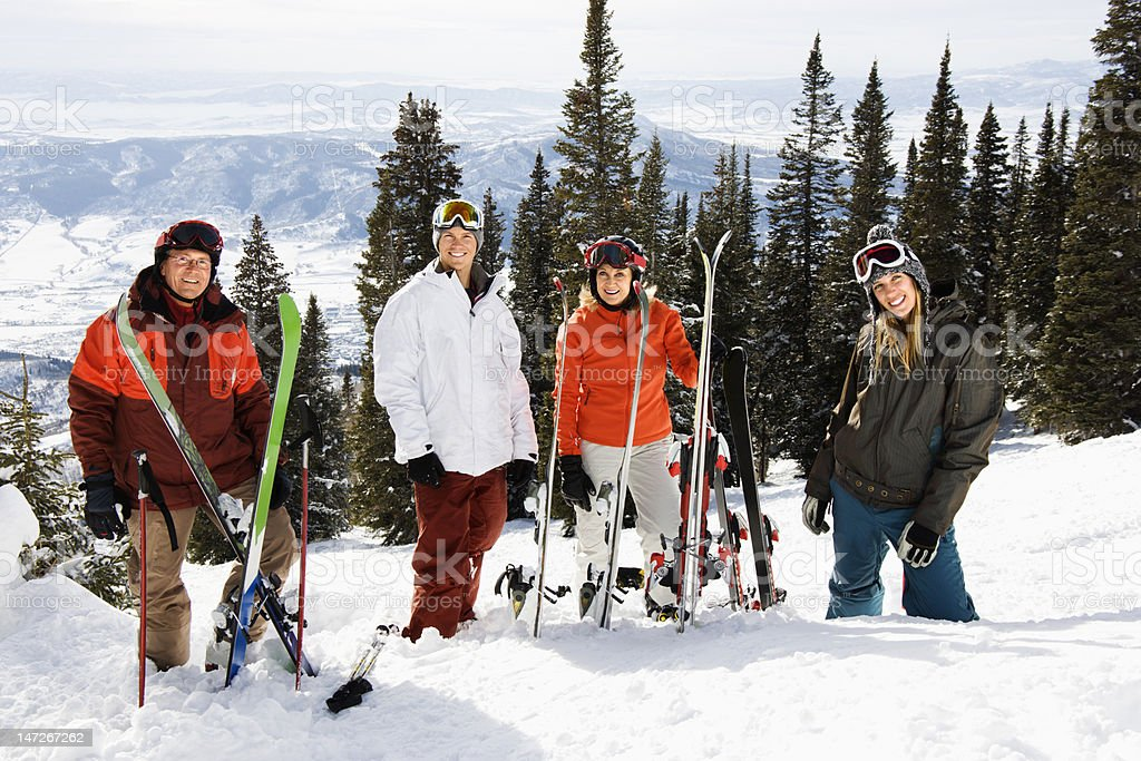 Skiers Standing in Snow Smiling royalty-free stock photo