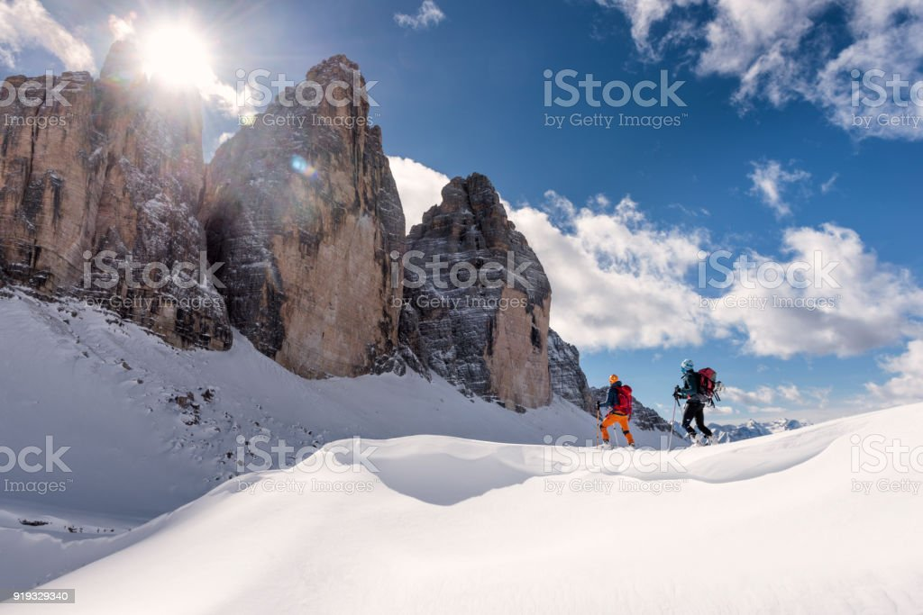 Skiers Touring Around the Cime in Dolomites, italy Side view of two young men ski touring in Dolomites, Italy, tre Cime in the background 20-24 Years Stock Photo