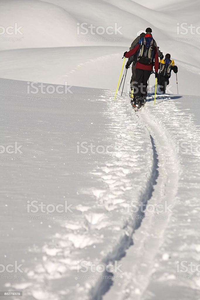 Skiers traverse of backcountry terrain. royalty-free stock photo