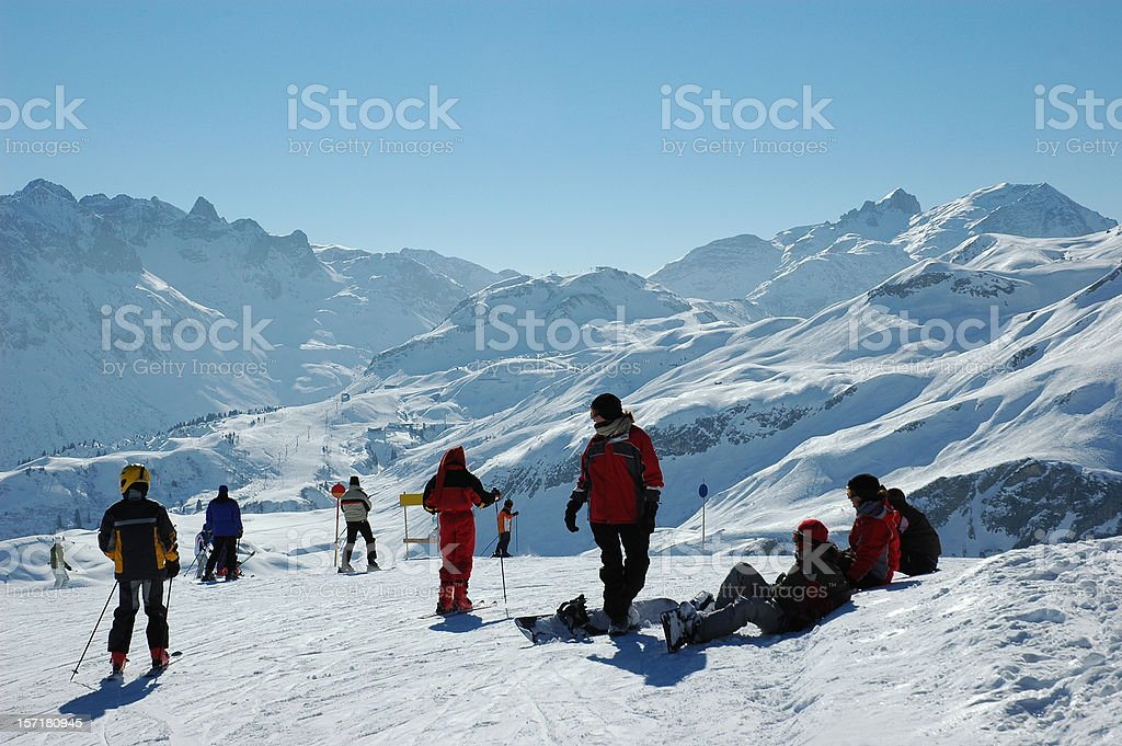 Skiers waiting at the top royalty-free stock photo