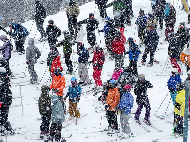 Skiers Waiting in a Chair Lift Line