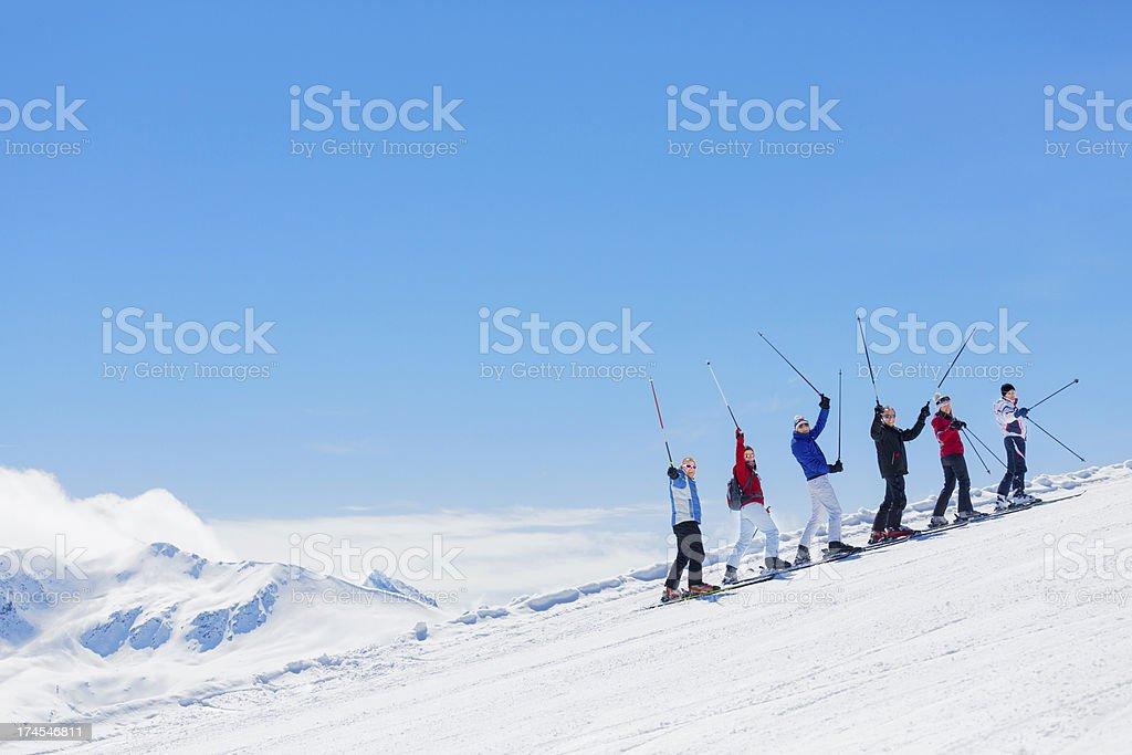 Ski-group climbs to the mountain top royalty-free stock photo