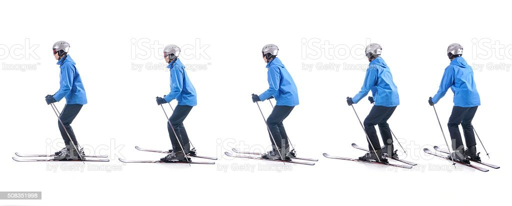 Skiier demonstrate how to turn around the tails of skis. stock photo