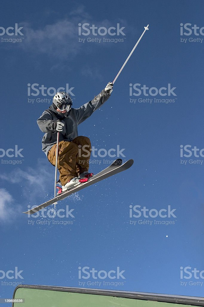 Skiier doing a rail stock photo