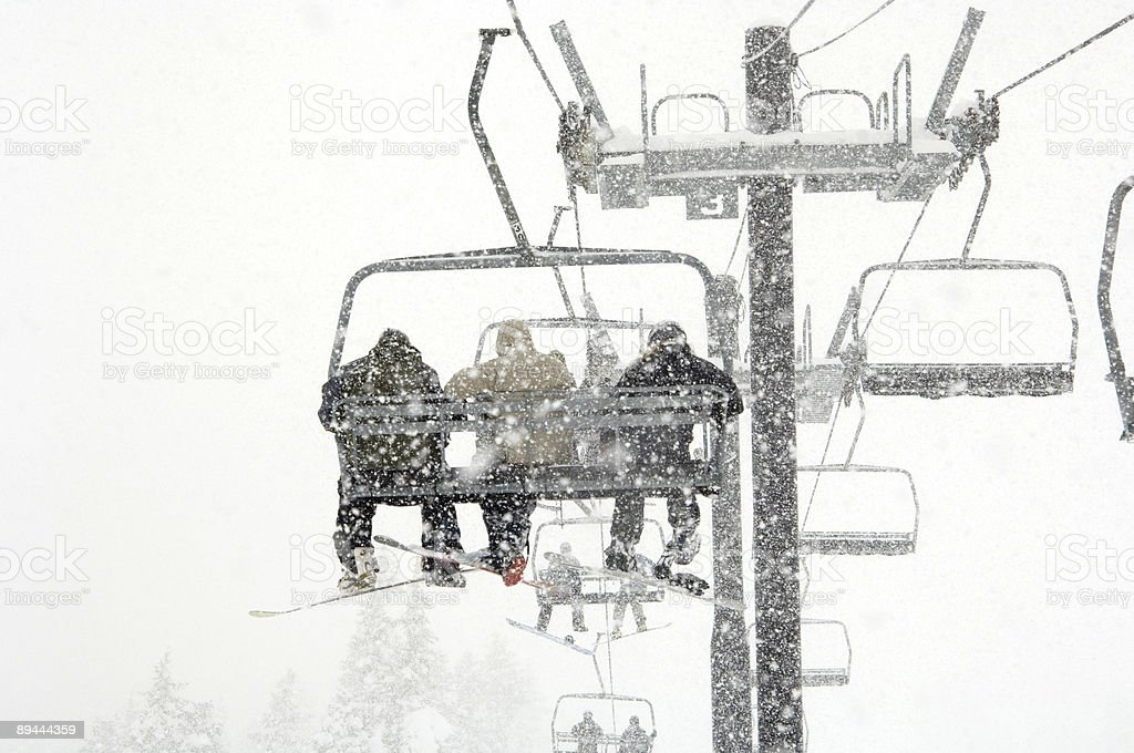 Skiiers in snow storm royalty-free stock photo