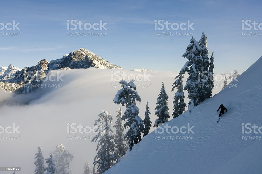 Skiing above clouds royalty-free stock photo