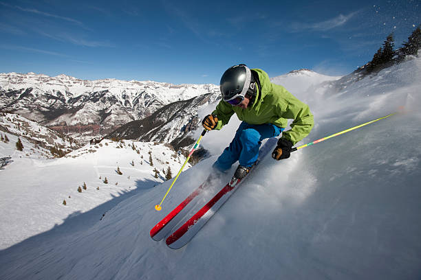 Skiing Action Skier on steep mountain slope steep stock pictures, royalty-free photos & images