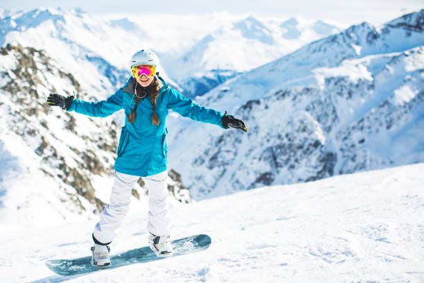 Skiing and snowboarding in Austria stock photo
