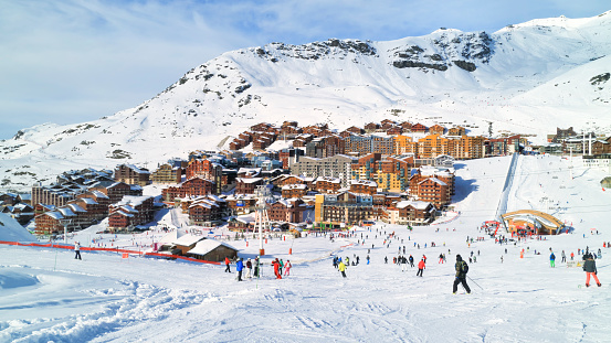 Skiing and snowboarding in French alpine winter resort