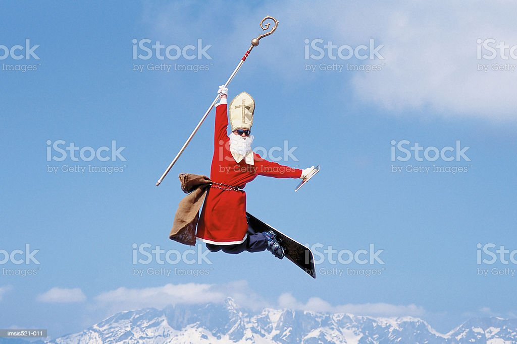 Skiing as a pope stock photo