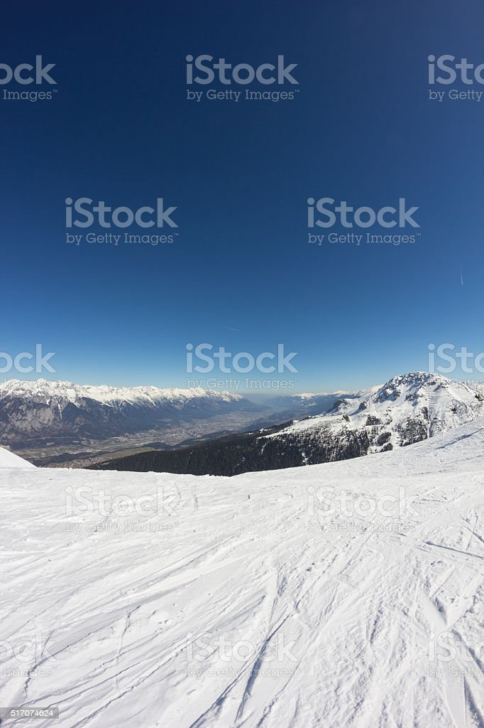 Skiing At Axamer Lizum With View To Innsbruck Tyrol Aaustria stock photo