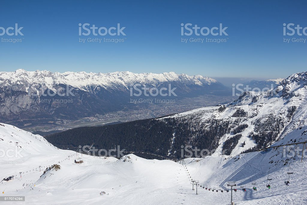 Skiing At Axamer Lizum With View To Innsbruck Tyrol Austria stock photo