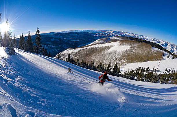 Skiing at Sunset Fisheye View Looking Down Mountain Scenic Angle Skiing at Sunset Fisheye View Looking Down Mountain Scenic Angle.  ProPhoto RGB. beaver creek colorado stock pictures, royalty-free photos & images
