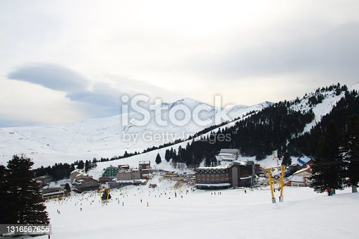 istock Skiing at the ski resort. 1316567655