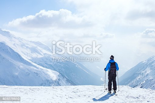 istock skiing background, skier in beautiful mountain landscape 623275510