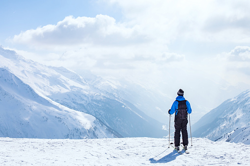 skiing background, skier in beautiful mountain landscape