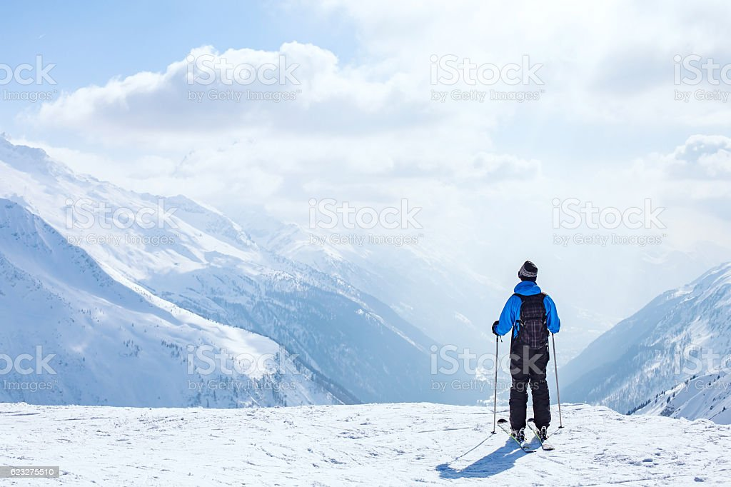 skiing background, skier in beautiful mountain landscape stock photo