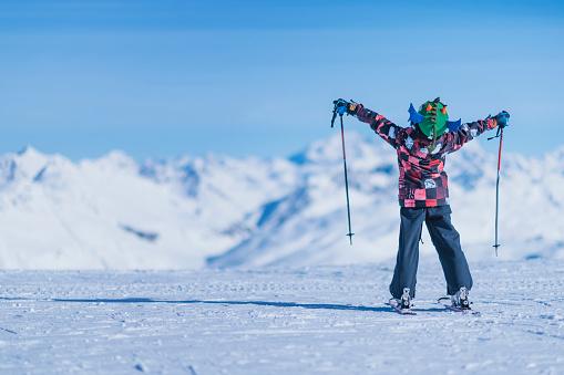Skiing Boy on a Mountain Top