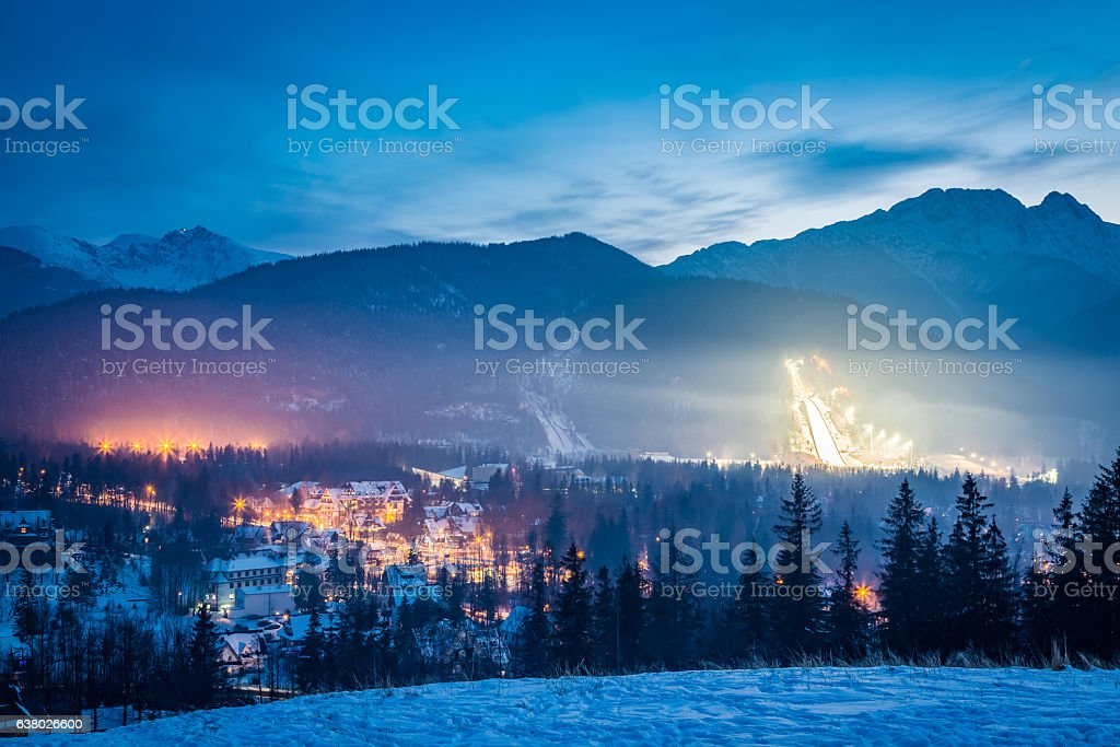Skiing competitions in Zakopane in winter at dusk in Poland stock photo