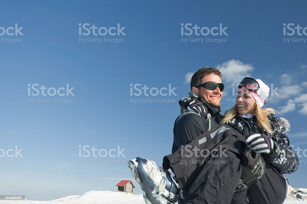 da455ba768f4 Skiing Couple In Love Stock Photo   More Pictures of 25-29 Years ...