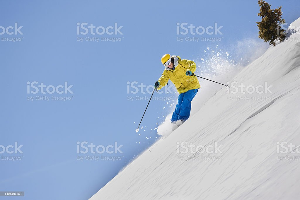 Skiing Downhill In Rocky Mountains royalty-free stock photo