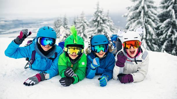 Skiing family having fun on winter day picture id1090053898?b=1&k=6&m=1090053898&s=612x612&w=0&h=rbi7liatf9cyepqjwjanb0hm7zhmzza8doidajdzwru=