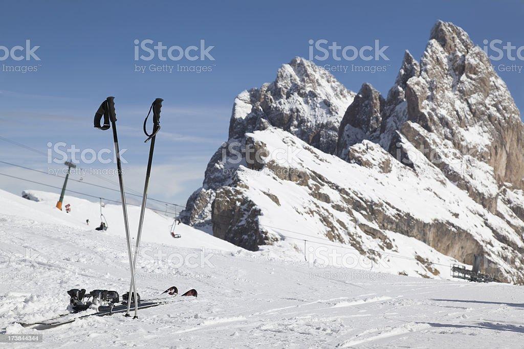 Skiing gear and mountain peak in Dolomites (XXXL) royalty-free stock photo