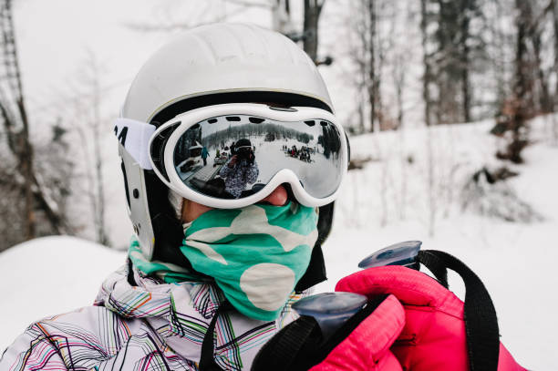 Skiing. Good skiing in the snowy mountains. Woman in ski mask on skis on snow in Carpathian. On background of forest and ski slopes. Close up. Winter nature. Nice winter day.