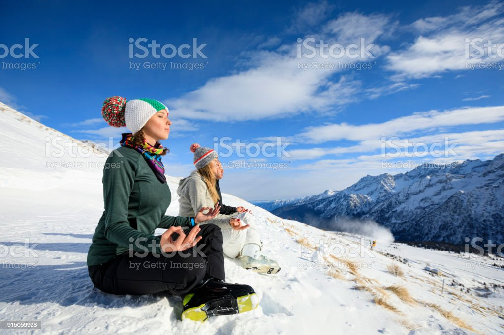 Skiing Happy skier class meditating on the mountain top Amateur...