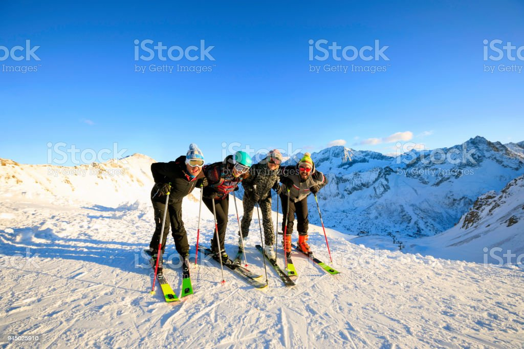 Amateur Winter Sports alpine skiing. Group of skiers. Best friends...