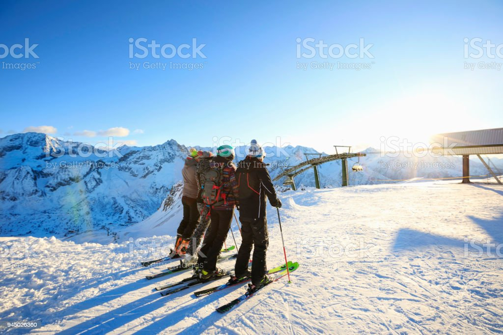 Skiing Happy skier class on the mountain top Amateur Winter Sports alpine  skiing. Group of skiers. Best friends men and women, snow skiers enjoying  on sunny ...