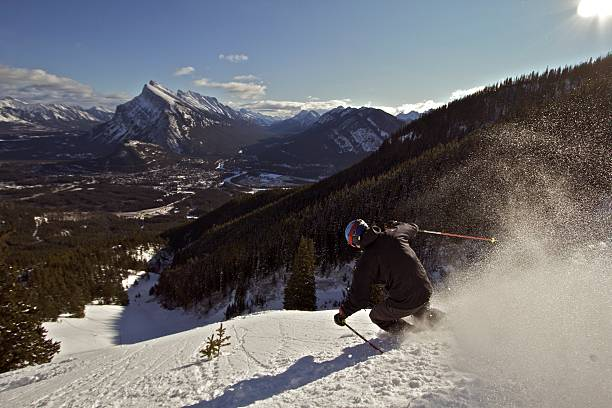 skiing in banff - banff national park stock photos and pictures
