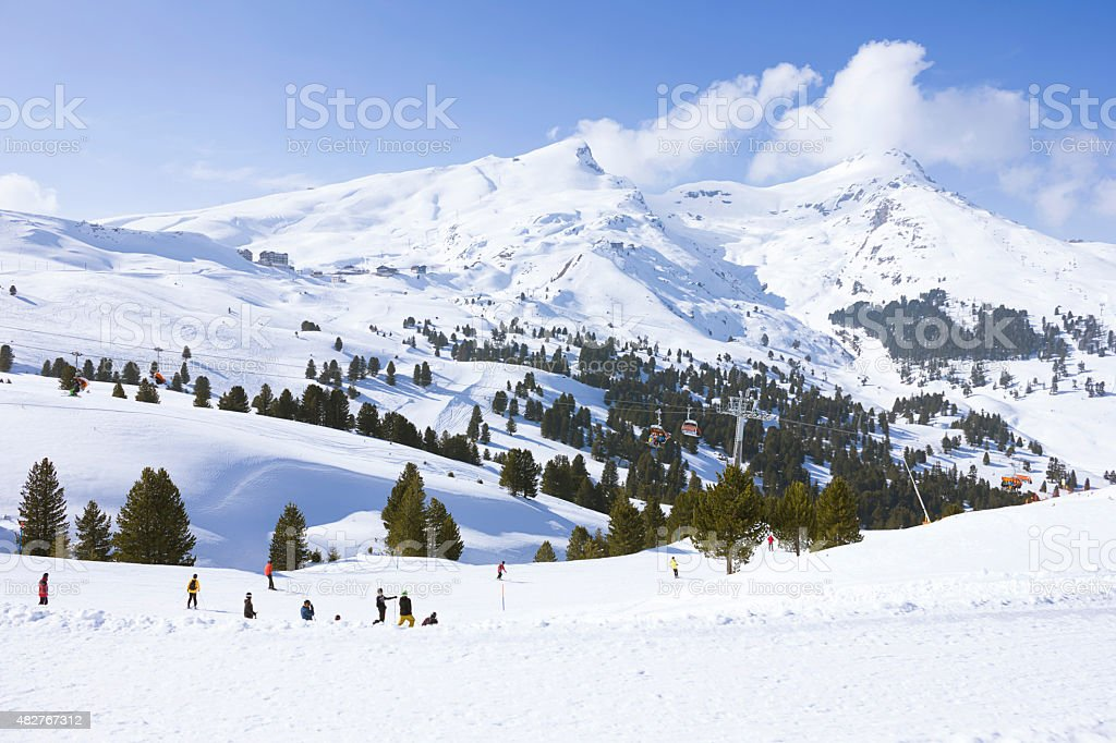 Skiing in swiss alps stock photo