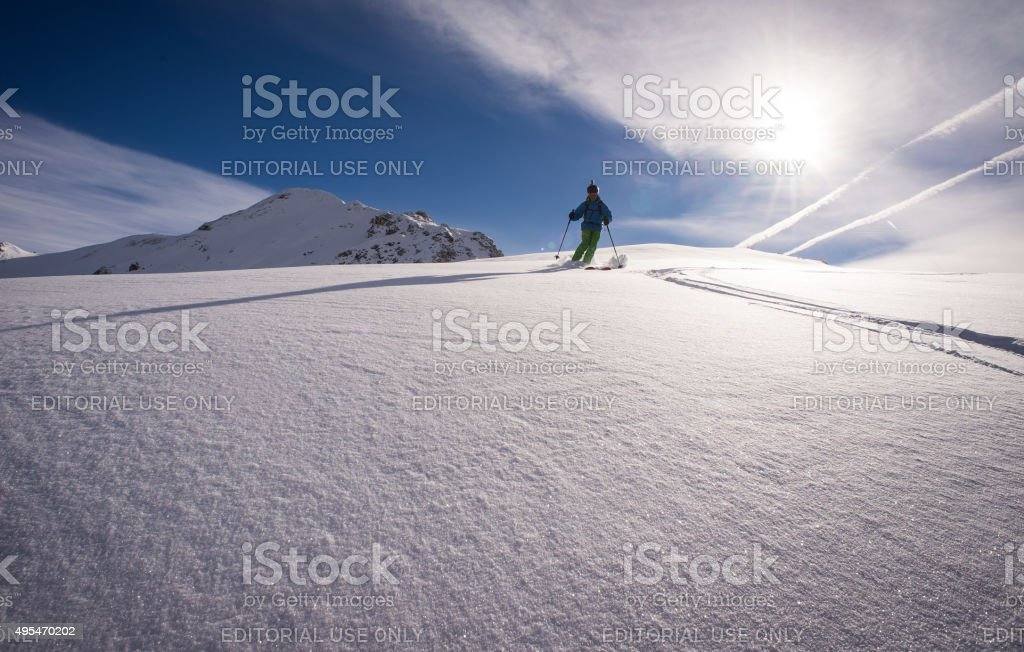 Verbier, Switzerland - 18th January 2015. A skier skiing in fresh...