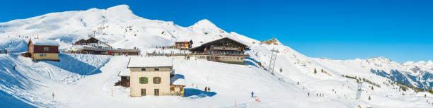 skiing in the alps snowy mountain winter sports resort switzerland - hotel alpenblick stock-fotos und bilder