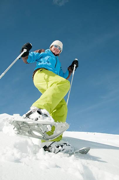 skiing in the snow wearing a blue jacket - winter austria train bildbanksfoton och bilder