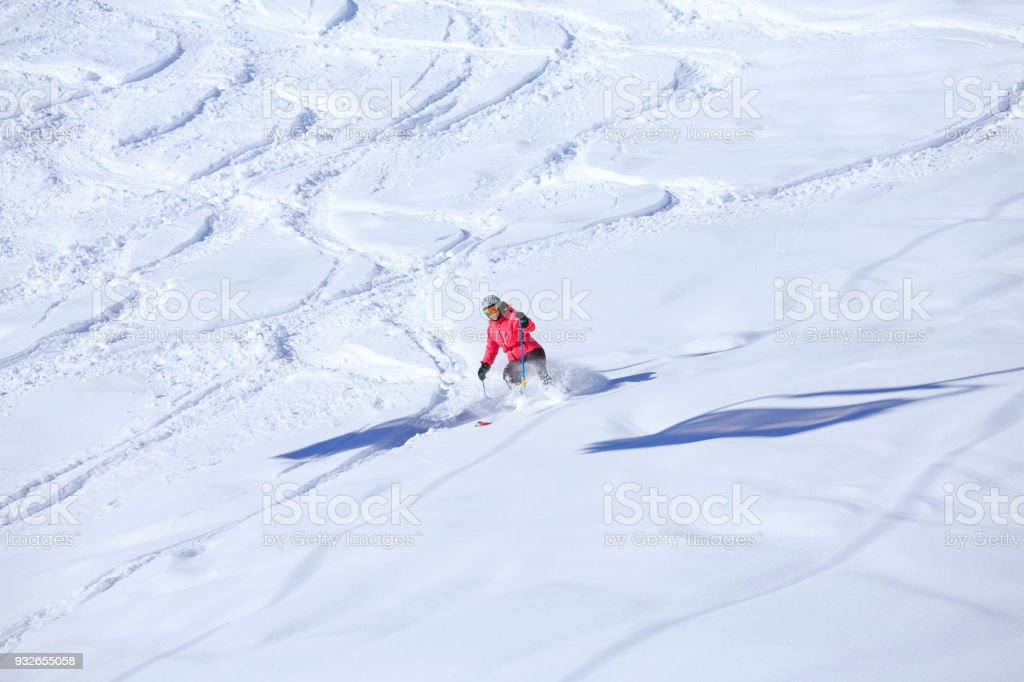 Skiing Off piste Amateur Winter Sports woman skier skiing in powder...
