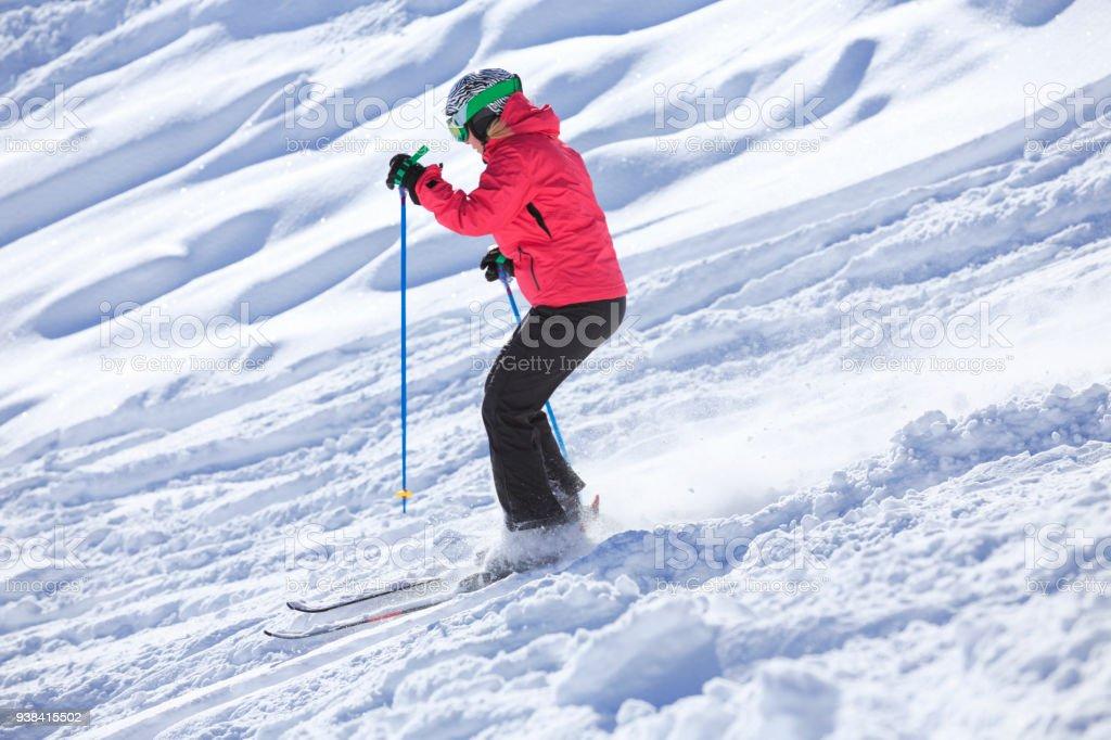 Skiing Off piste Amateur Winter Sports woman skier skiing in powder...