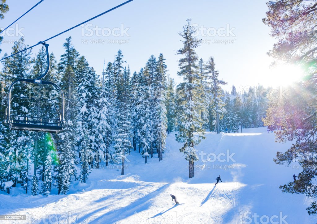 Skiing on a beautiful day - view from the chair lift royalty-free stock photo