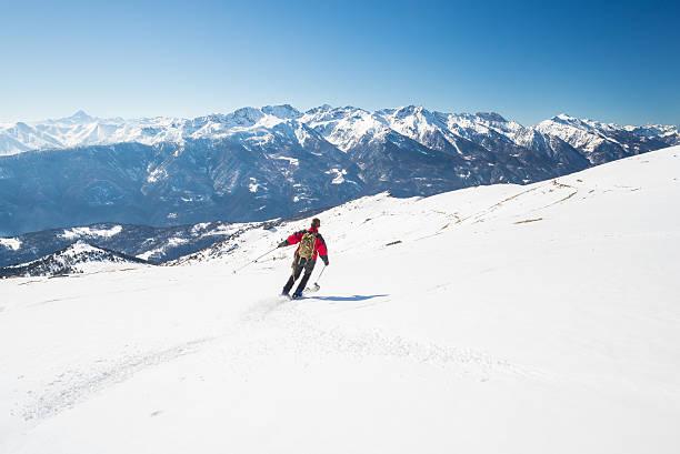 Skiing on the majestic italian alpine arc stock photo