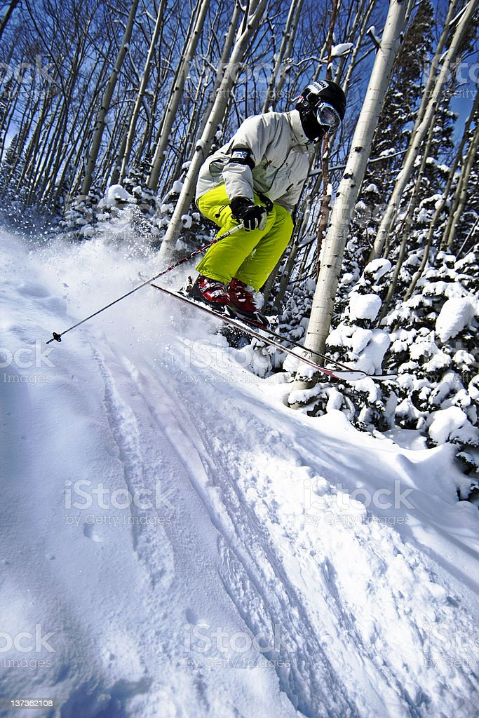 Skiing over a jump stock photo