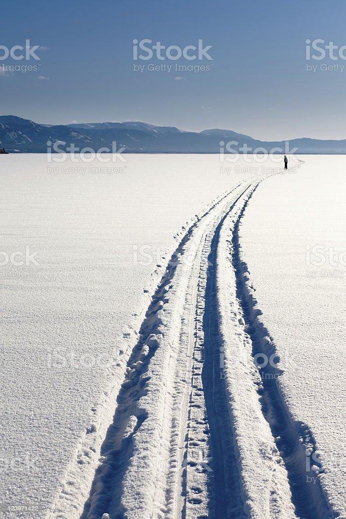 Skiing person on frozen lake stock photo