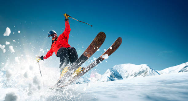Skiing Skiing. Jumping skier. Extreme winter sports. ski stock pictures, royalty-free photos & images