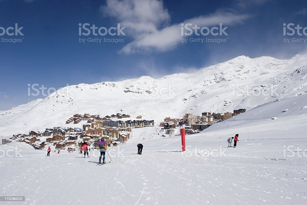 Skiing towards the village royalty-free stock photo