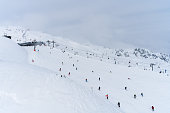 Lots of people skiing on a track  on the Hochzillertal mountain, Tyrol, Austria