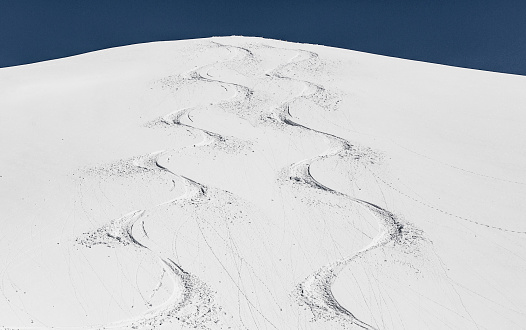 Skiing tracks in mountain slope